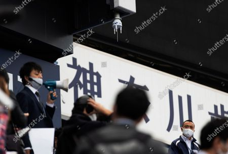 This photo shows a device, center top, to detect wind velocity installed over the seats of a baseball stadium, home for the Yokohama DeNA BayStars, in Yokohama, south of Tokyo on . The device was introduced during a media tour before a Japanese professional baseball league game between the Hanshin Tigers and the DeNA BayStars on Friday