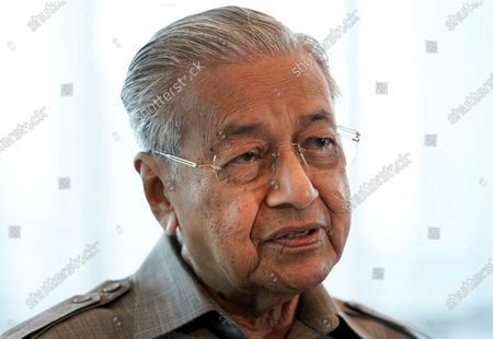 Former Prime Minister Mahathir Mohamad speaks during an interview with The Associated Press in Kuala Lumpur. Mahathir said, he is disgusted because his comments on attacks by Muslim extremists in France had been taken out of context