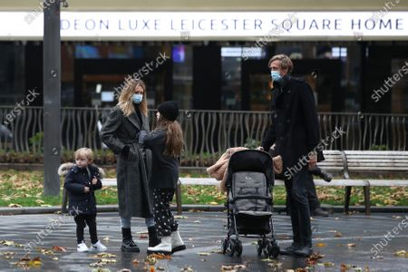 Abbey Clancy and Peter Crouch are seen in Leicester Square with their children