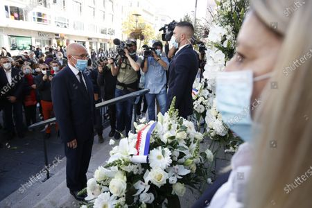 Member of the French Parliament Eric Ciotti pays his respect to the victims of the knife attack at a makeshift memorial at the entrance of the Notre Dame Basilica church in Nice, France, 30 October 2020. Three people have died in a terror attack. The attack comes less than a month after the beheading of a French middle school teacher in Paris on 16 October.