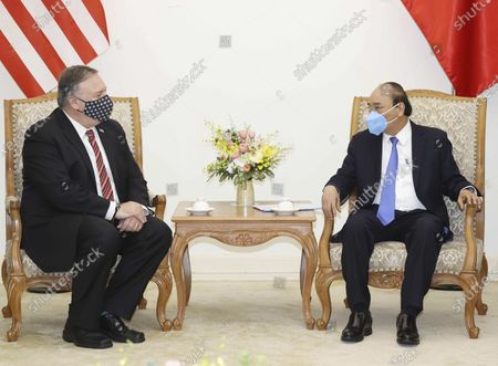 Secretary of State Mike Pompeo and Vietnamese Prime Minister Nguyen Xuan Phuc sit for a meeting in Hanoi, Vietnam, Friday, 30, 2020. Pompeo wrapped up a five-nation, anti-China tour of Asia in Vietnam on Friday with a call for regional unity to counter Beijing's growing assertiveness, as the fierce American presidential election race entered its final stretch