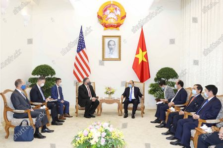 Secretary of State Mike Pompeo, center left, and Vietnamese Prime Minister Nguyen Xuan Phuc, center right, meet in Hanoi, Vietnam, Friday, 30, 2020. Pompeo wrapped up a five-nation, anti-China tour of Asia in Vietnam on Friday with a call for regional unity to counter Beijing's growing assertiveness, as the fierce American presidential election race entered its final stretch