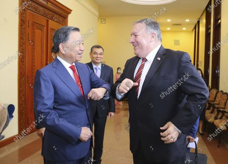 Secretary of State Mike Pompeo and Vietnamese Minister of Public Security To Lam elbow as a greeting ahead of a meeting in Hanoi, Vietnam, Friday, 30, 2020. Pompeo wrapped up a five-nation, anti-China tour of Asia in Vietnam on Friday with a call for regional unity to counter Beijing's growing assertiveness, as the fierce American presidential election race entered its final stretch