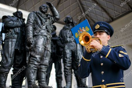 Stock Picture of Paying tribute to those who made the ultimate sacrifice during the Second World War. Bugler Corporal Benjamin Murray plays for the 55,573 men killed in Bomber Command.