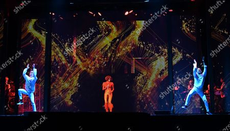 Stock Photo of A hologram of late US singer Whitney Houston (C) is seen during the dress rehearsal of 'An Evening with Whitney Houston' in Madrid, Spain, 30 October 2020. The musical will be world premiered on 31 October 2020 in Madrid after its presentation in Las Vegas had to be postponed due to the ongoing coronavirus pandemic.