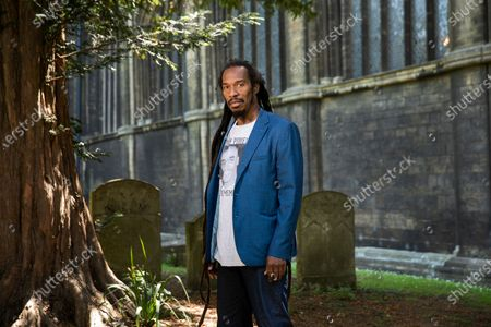 Stock Photo of Poet and writer Benjamin Zephaniah in the grounds of Peterborough Cathedral near where he lives. Benjamin is wearing a t-shirt in memory of his cousin Mikey Powell who died in police custody and is helping to campaign for justice.