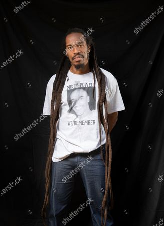 Poet and writer Benjamin Zephaniah in the grounds of Peterborough Cathedral near where he lives. Benjamin is wearing a t-shirt in memory of his cousin Mikey Powell who died in police custody and is helping to campaign for justice.