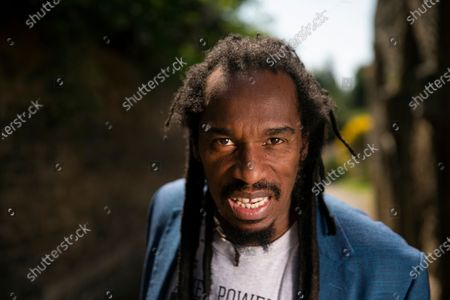 Stock Picture of Poet and writer Benjamin Zephaniah in the grounds of Peterborough Cathedral near where he lives. Benjamin is wearing a t-shirt in memory of his cousin Mikey Powell who died in police custody and is helping to campaign for justice.