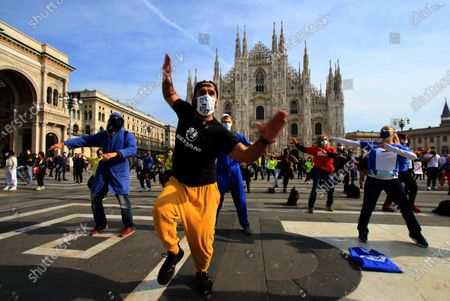 The sports workers of gyms, swimming pools and sports centers stage a flashmob to protest against the forced closure of their activities due to the government's Covid-19-linked restrictions, in Milan, Italy, 30 October 2020. Italian government's latest restrictions are aimed at combatting the spread of Covid-19 after a sharp upswing in contagion. Among other things, the new restrictions, the latest in a series of measures passed by Giuseppe Conte's executive, mean Italy's bars and restaurants must stop serving customers at 6 p.m. and cinemas, threatres, swimming pools and gyms must close completely.