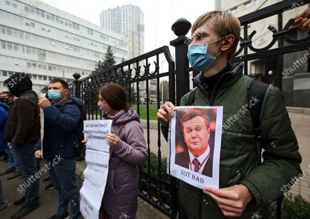 Activist holds a portrait of an Ex-President of Ukraine Viktor Yanukovych in protest against the CCU decision to cancel online customs filing outside the Constitutional Court of Ukraine, Kyiv, capital of Ukraine.
