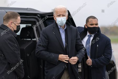 Democratic presidential candidate former Vice President Joe Biden arrives to board his campaign plane at New Castle Airport in New Castle, Del., to travel to Des Moines, Iowa. Biden is holding rallies today in Des Moines, Iowa, Saint Paul, Minn., and Milwaukee, Wis
