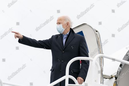 Democratic presidential candidate former Vice President Joe Biden boards his campaign plane at New Castle Airport in New Castle, Del., to travel to Des Moines, Iowa. Biden is holding rallies today in Des Moines, Iowa, Saint Paul, Minn., and Milwaukee, Wis