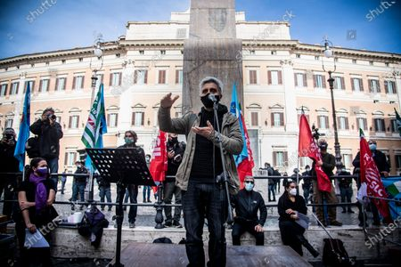 Stock Image of Theatrical actor, writer, director Ascanio Celestini attends at the sit in of the culture and industry workers against the measures implemented by the new Dpcm that impose the closure of cinemas and theaters in Montecitorio square