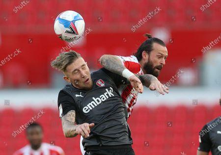 Rotherham's Angus MacDonald battles with Stoke City's Stephen Fletcher