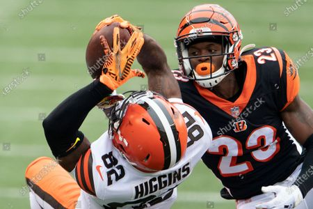 Stock Photo of Cleveland Browns wide receiver Rashard Higgins (82) reaches for a pass as Cincinnati Bengals cornerback Darius Phillips (23) defends during an NFL football game in Cincinnati. The sure-handed wide receiver came in last week and made several clutch catches for the Browns after Odell Beckham Jr. got hurt