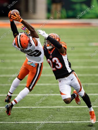 Cleveland Browns wide receiver Rashard Higgins (82) reaches for a pass as Cincinnati Bengals cornerback Darius Phillips (23) defends during an NFL football game in Cincinnati. The sure-handed wide receiver came in last week and made several clutch catches for the Browns after Odell Beckham Jr. got hurt