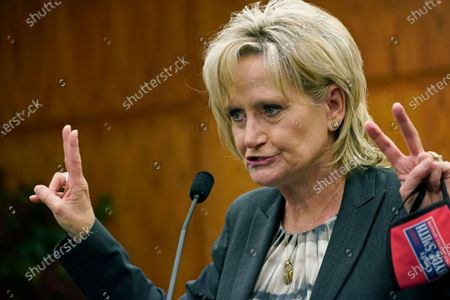 Incumbent Republican U.S. Sen. Cindy Hyde-Smith, gestures as she speaks at a campaign stop at the Richland, Miss., City Hall, . In a rematch of a 2018 special election, Democrat Mike Espy is trying to unseat Hyde-Smith, the first woman to represent the state in Congress. She also faces Libertarian candidate Jimmy Edwards on the Nov. 3, 2020 ballot