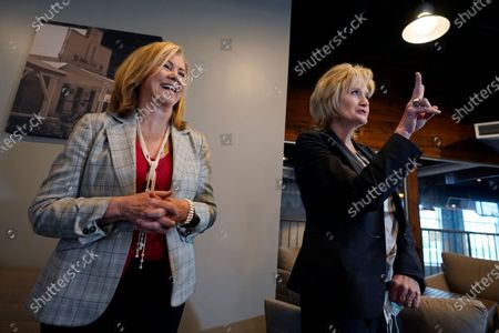 Incumbent Republican U.S. Sen. Cindy Hyde-Smith, right, gestures as she speaks as fellow Republican, U.S. Sen. Marsha Blackburn of Tennessee laughs, during a Thursday press briefing, in Madison, Miss. Blackburn appeared with Hyde-Smith at a closed luncheon before supporters. In a rematch of a 2018 special election, Democrat Mike Espy is trying to unseat Hyde-Smith, the first woman to represent the state in Congress. She also faces Libertarian candidate Jimmy Edwards on the Nov. 3 ballot