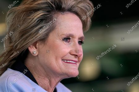 Incumbent Republican U.S. Sen. Cindy Hyde-Smith, braves a brisk wind to address a virtual crowd at the Mississippi Economic Council's Hobnob gathering at Trustmark Park in Pearl, Miss., . The event was broadcast over the internet, aimed at business and community leaders statewide. In a rematch of a 2018 special election, Democrat Mike Espy is trying to unseat Hyde-Smith, the first woman to represent the state in Congress. She also faces Libertarian candidate Jimmy Edwards on the Nov. 3 ballot