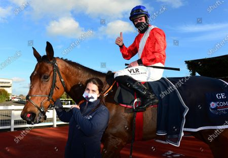 Down Royal ENVOI ALLEN & jack Kennedy with Seainin Mahon after winning the Advanced Scaffolding Beginners Steeplechase.