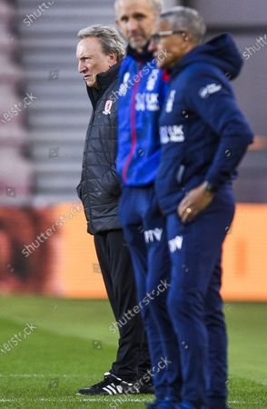 Manager Neil Warnock of Middlesbrough in the back ground with Manager Chris Hughton of Nottingham Forest in front