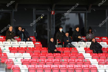 Gary Neville, Ryan Giggs, Roy Keane, Phil Neville and Nicky Butt sit with guests