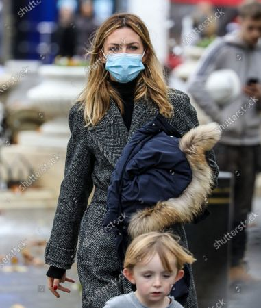Stock Picture of Abigail Clancy with her kid spotted on a family day out in London.
