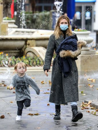 Abigail Clancy with her kid spotted on a family day out in London.