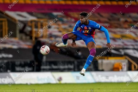 Wilfried Zaha of Crystal Palace tries to control the ball in the air; Molineux Stadium, Wolverhampton, West Midlands, England; English Premier League Football, Wolverhampton Wanderers versus Crystal Palace.