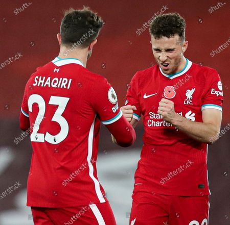 Diogo Jota of Liverpool with Xherdan Shaqiri at the end of the match