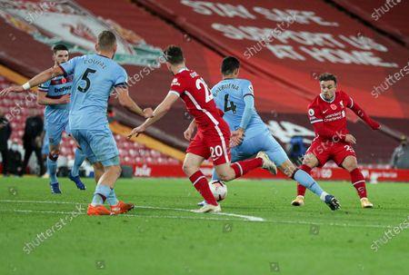 Xherdan Shaqiri of Liverpool send a ball through to Diogo Jota before he scored the 2nd goal