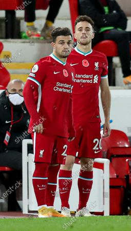 Diogo Jota of Liverpool and Xherdan Shaqiri wait to come on as substitutes