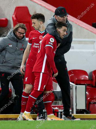 Liverpool manager Jurgen Klopp hugs Xherdan Shaqiri before he comes on as a substitute