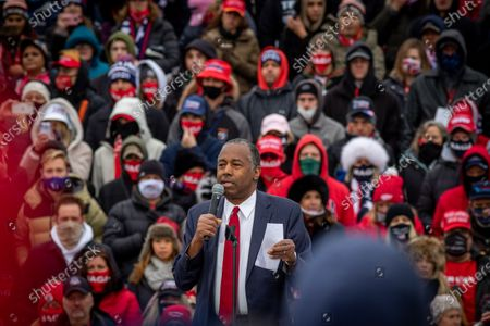 Secretary of the U.S. Department of Housing and Urban Development Dr. Benjamin S. Carson, Sr., M.D., delivers a speech prior to the start oif the rally. U.S. President Donald Trump delivers remarks at a Make America Great Again Rally in Waterford Township, Michigan on Friday, 30 October, 2020.