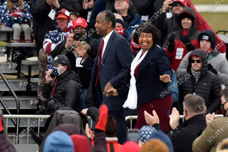 Housing and Urban Development Secretary Ben Carson, left, and his wife, Candy Carson, walk on stage at a campaign rally for President Donald Trump at Oakland County International Airport, in Waterford Township, Mich