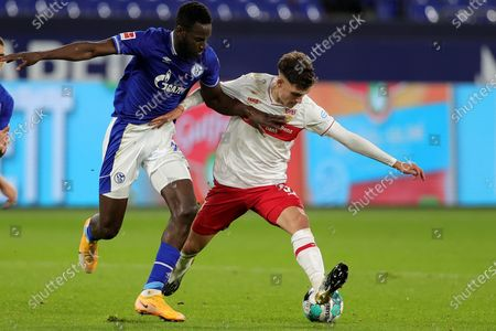Stuttgart's Mateo Klimowicz (R) in action against Schalke's Salif Sane (L) during the German Bundesliga soccer match between FC Schalke 04 and VfB Stuttgart at Veltins-Arena in Gelsenkirchen, Germany, 30 October 2020.