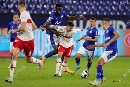 Stuttgart's Mateo Klimowicz (C-front) in action against Schalke's Salif Sane (C-rear) during the German Bundesliga soccer match between FC Schalke 04 and VfB Stuttgart at Veltins-Arena in Gelsenkirchen, Germany, 30 October 2020.