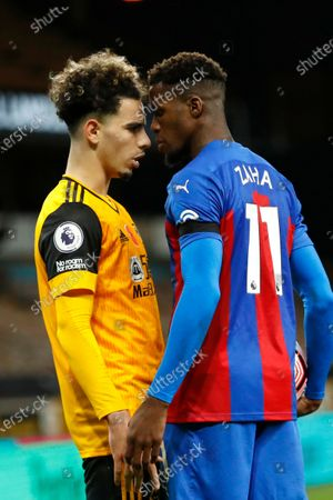 Wolverhampton Wanderers' Rayan Ait-Nouri, left, argues with Crystal Palace's Wilfried Zaha after a tackle during the English Premier League soccer match between Wolverhampton Wanderers and Crystal Palace at the Molineux Stadium in Wolverhampton, England