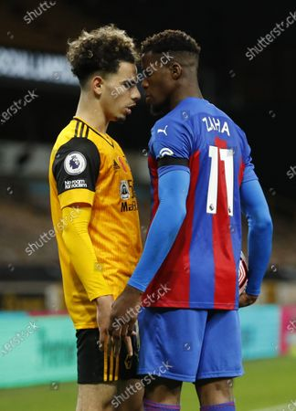 Rayan Ait-Nouri of Wolverhampton (L) argues against Wilfried Zaha of Crystal Palace (R) during the English Premier League match between Wolverhampton Wanderers and Crystal Palace in Wolverhampton, Britain 30 October 2020.