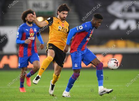 Ruben Neves of Wolverhampton (C) in action against Wilfried Zaha of Crystal Palace (R) during the English Premier League soccer match between Wolverhampton Wanderers and Crystal Palace in Wolverhampton, Britain, 30 October 2020.