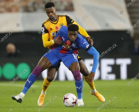 Nelson Semedo of Wolverhampton (L) in action against Wilfried Zaha of Crystal Palace (R) during the English Premier League match between Wolverhampton Wanderers and Crystal Palace in Wolverhampton, Britain 30 October 2020.