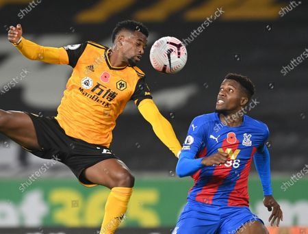 Nelson Semedo of Wolverhampton (L) in action against Wilfried Zaha of Crystal Palace (R) during the English Premier League soccer match between Wolverhampton Wanderers and Crystal Palace in Wolverhampton, Britain, 30 October 2020.