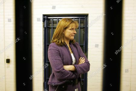 Claudia Sturt Prison Governor At Belmarsh Prison Woolwich London The Governor Of High-security Belmarsh Prison Told Today Of The Challenge Of Having Suspected Would-be Suicide Bombers As Inmates. Claudia Sturt Defended The Jail As It Was Criticised In An Official Report For The Way It Deals With Muslim Inmates. Prisons Chief Inspector Anne Owers Warned That Belmarsh - Britain's Most Secure Prison - Is Struggling To Cope With A Large Number Of Terror Suspects And Dangerous Offenders. Her Report Says That Muslim Gangs Are Operating In The Prison And There Is Bullying And Evidence Of Black And Ethnic Minority Inmates Receiving Worse Treatment Than Whites. It Also Raises Concern Over A Decision To Prevent The Four Men Charged Over The 21 July Failed London Bombings From Attending Friday Prayers With Other Muslims And From Mixing With Fellow Inmates. Ms Owers Also Criticises How A Fifth Inmate Charged With Terrorist Offences Is Kept In Total Isolation. But Ms Sturt 38 Said That The Prison Had Faced An Unprecedented Situation And That She Would Do The Same Again With The 21 July Suspects.