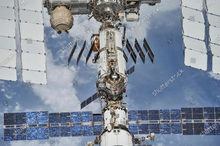 In this photo provided by NASA/Roscosmos, the International Space Station floats above the Earth as seen from a Soyuz spacecraft after undocking on . NASA astronauts Andrew Feustel and Ricky Arnold and Roscosmos cosmonaut Oleg Artemyev executed a fly around of the orbiting laboratory to take pictures of the station before returning home after spending 197 days in space. Twenty years after the first crew arrived, the space station has hosted 241 residents