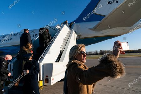 Fox News Laura Ingraham takes a picture before boarding Air Force One to accompany President Donald Trump, at Green Bay Austin Straubel International Airport, in Green Bay, Wis