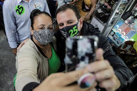 The candidate to Rio de Janeiro Mayor for Democratas Party Eduardo Paes (R) poses with a supporter during a campaign act in Rio de Janeiro, Brazil, 30 October 2020. Brazil will hold local elections on 15 and 28 November 2020.
