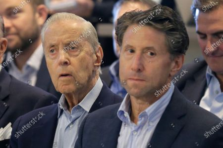New York Mets owners Fred, left, and Jeff Wilpon attend a baseball news conference at Citi Field in New York. Major League Baseball owners voted, to approve the sale of the New York Mets to billionaire hedge fund manager Steve Cohen. The sale from the Wilpon and Katz families values the franchise at between $2.4 billion and $2.45 billion, a record for a baseball team. The sale is likely to close within 10 days