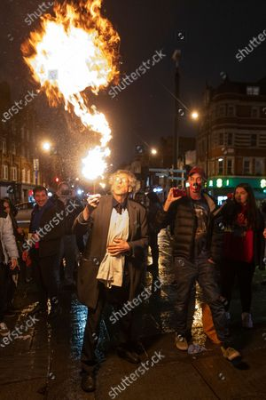 Editorial photo of Piers Corbyn Fire Breathing at anti Covid-19 Street Party, London, UK - 30 Oct 2020