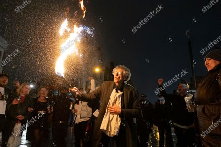 Stock Photo of PIERS CORBYN is seen practicing fire breathing in front of demonstrators attending an anti Covid-19 street party in Camden Town, North London. The event was held in support of the hospitality industry who have operated under strict lockdown rules. Police officers did not intervene in the demonstration.