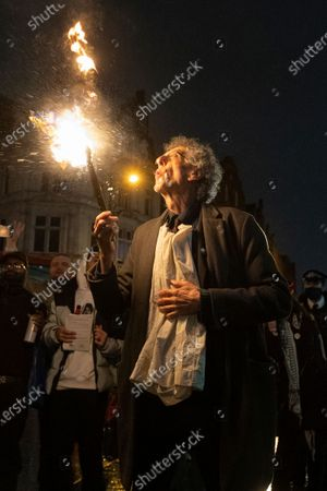 PIERS CORBYN is seen practicing fire breathing in front of demonstrators attending an anti Covid-19 street party in Camden Town, North London. The event was held in support of the hospitality industry who have operated under strict lockdown rules. Police officers did not intervene in the demonstration.